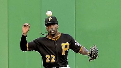 Pirates center fielder Andrew McCutchen runs down hit by the Giants' Melky Cabrera Friday night at PNC Park.