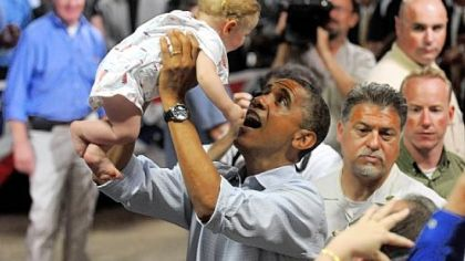 President Barack Obama lifts 9-month-old Nathan Maxwell Johnson of Youngstown into the air Friday after speaking at a campaign event at Dobbins Elementary School in Poland, Ohio.