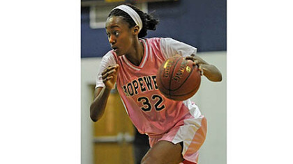 Shatori Walker-Kimbrough drives to the basket in a game earlier this year.