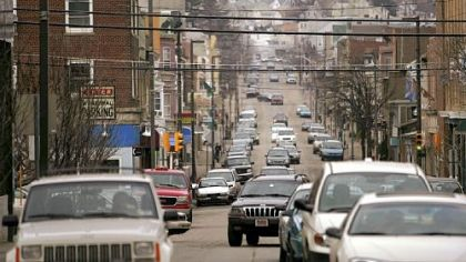 Cars move through downtown Hazleton, where a new city ordinance has caused members of its large Latino community to fear discrimination and to have concern for their future in the town.