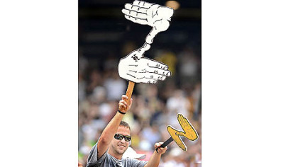 A fan shows support with a Zoltan sign Saturday at PNC Park.