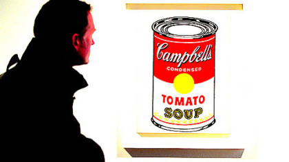 "The origin of the idea for Andy Warhol's soup cans, like the ""Campbell's Soup Can (Tomato),"" has long been the subject of debate."