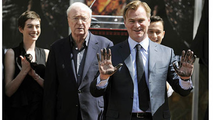 Christopher Nolan director of the film &quot;The Dark Knight Rises,&quot; holds up his hands after putting them in cement during a ceremony for him at Grauman&#039;s Chinese Theatre.