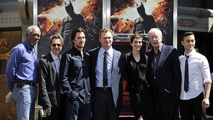 &quot;The Dark Knight Rises&quot; director Christopher Nolan, fourth from left, poses Saturday with cast members at his hand and footprint ceremony at Grauman&#039;s Chinese Theatre in Los Angeles.