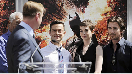 Christopher Nolan director of the upcoming film &quot;The Dark Knight Rises,&quot; looks over at cast members, Morgan Freeman, Joseph Gordon-Levitt, Anne Hathaway and Christian Bale during his hand-and-footprint ceremony at Grauman&#039;s Chinese Theatre.
