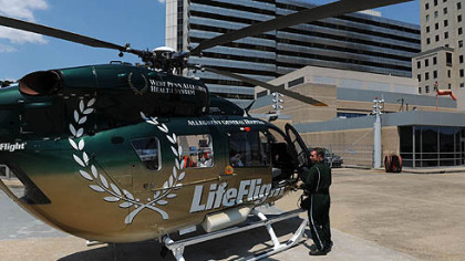 Pilot Dave Murphy checks over his LifeFlight helicopter on the landing pad at Allegheny General Hospital.