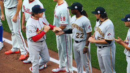 National League manager Tony La Russa is introduced as he shakes Andrew McCutchen's hand before the 83rd MLB All-Star Game at Kauffman Stadium in Kansas City, Missouri.