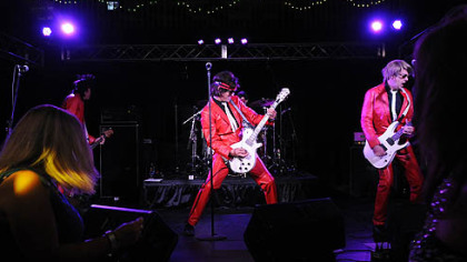 Flash Back Heart Attack rocks the crowd at a Ben Roethlisberger Foundation event Sunday at Jergel's Rhythm Grill in Warrendale.