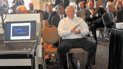 Doug Farnham watches a video presentation about coal production during the press conference.