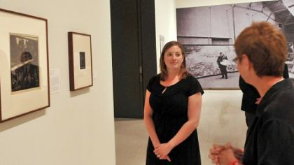 Alana Stieglitz Kanawalsky, a great-grandniece of the famed early 20th-century photographer Alfred Stieglitz, talks about her family as she stands in front of a portrait of Stieglitz right.