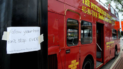 One of Gabrielle Bovard's notes is seen taped to a double decker bus at the South Side Works. Five years ago, Ms. Bovard, 25, began writing inspirational messages on notes and leaving them around Pittsburgh.