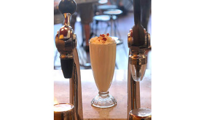Applewood bacon milkshake served up in a traditional glass at The Milk Shake Factory.