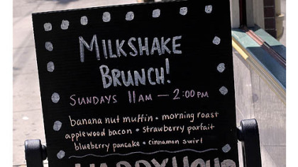 Sign in front of The Milk Shake Factory on Carson Street announcing milkshake brunch.