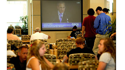 Penn State students watch the Freeh report press conference on a television in the HUB-Robeson Center on the campus of Penn State University.