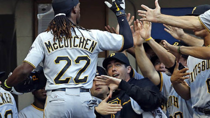 Andrew McCutchen is greeted by his teammates at the dugout after he hit a two-run home run off Milwaukee Brewers' Marco Estrada during the third inning.