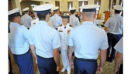 Incoming commander Lindsay N. Weaver, center, greets members of her unit during a traditional inspection of personnel during the Coast Guard change of command ceremony at the University Club in Oakland on Friday. Cmdr. Weaver will be the first female commanding officer and the first Latina top officer at Pittsburgh's Marine Safety Unit.