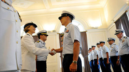 Incoming Commander Lindsay Weaver, left, shakes hands with members of her unit during a traditional inspection of personnel during a US Coast Guard MSU Change of Command Ceremony held at the University Club in Oakland on Friday, July 13, 2012.  Weaver will be the first female commanding officer of the US Coast Guard MSU in Pittsburgh.