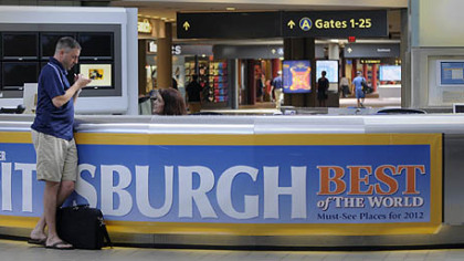 A traveler gets questions answered at the information desk at Pittsburgh International Airport.