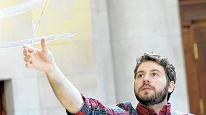 Ben Saks of CMU flies an ultralight plane at the Fine Arts Building.