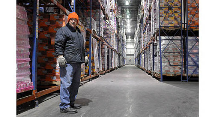 Dennis Nemanic, the inventory control manager at Great Lakes Cold Storage, stands in the coldest freezer room, which primarily stores ice cream at minus 15 degrees. He has been with the company for nine years.