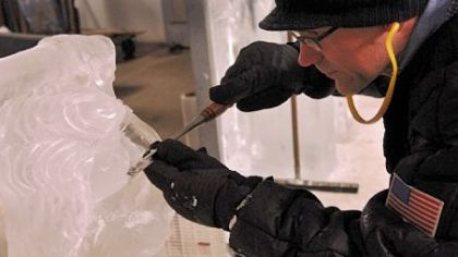 Dan Shaffer, an ice sculptor for the Mastro Ice Co., wears gloves as he works in a freezer room at the Herron Avenue company on a display piece to be sent to a local golf club.