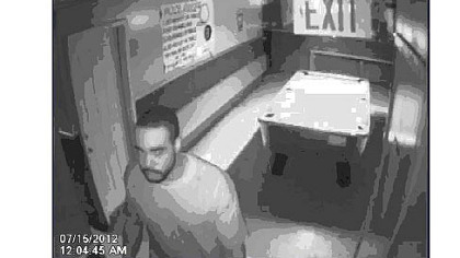 A surveillance photo of an unknown man who accompanied Antwon Underwood to the Earl the Pearl bar. He was last seen running with a firearm after a man on the 7200 block of Kelly Street in Homewood.