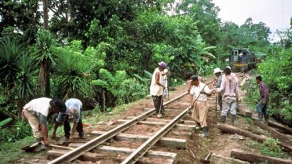 A track gang replaces ties near Puerto Barrios, Guatemala. In December 1999, commercial service was restored from Guatemala City, to the Atlantic ports of Puerto Barrios and Puerto Santo Tomas.