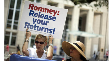 Sharon Simon left, and Ellen Bander, of Baton Rogue, La., protest outside a fundraiser for Republican presidential candidate, former Massachusetts Gov. Mitt Romney on Monday.