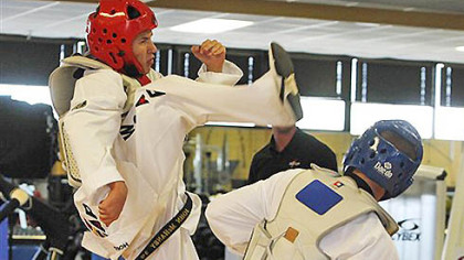 John Haney Jr., left, demonstrates a kick to the head of Ryan McCall at the Army&#039;s World Class Athlete training center at Fort Carson, Colo., on Monday, July 16, 2012. The U.S. Army is sending 11 soldiers to the Olympics.