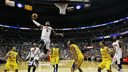 Team USA forward LeBron James goes up for a dunk in front of Brazil forward Anderson Varejao during the first half of an Olympic men&#039;s exhibition basketball game, July 16, 2012, in Washington. USA won 80-69.