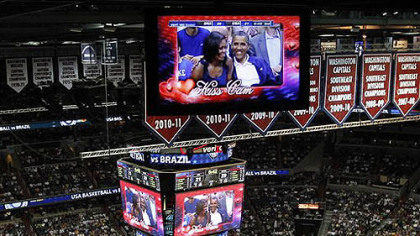 President Barack Obama and first lady Michelle Obama are seen on the in-house television monitors during the &#039;Kiss Cam&#039; segment as they attend the U.S. men&#039;s Olympic basketball exhibition game between Team USA and Brazil in Washington, Monday, July 16, 2012.