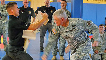 Sgt. Major Donald Felt demonstrates breaking boards being held by SFC David Bartlett at the Army&#039;s World Class Athlete training center at Fort Carson, Colo., on Monday, July 16, 2012. The U.S. Army is sending 11 soldiers to the Olympics. The soldiers include both coaches and athletes competing in wrestling, shooting, race walking, the modern pentathlon and boxing.