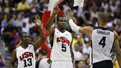 Team USA&#039;s Chris Paul (13), Kevin Durant (5), and Tyson Chandler (4) celebrate during the second half of a men&#039;s Olympic exhibition basketball game against Brazil, Monday, July 16, 2012, in Washington. USA won 80-69.