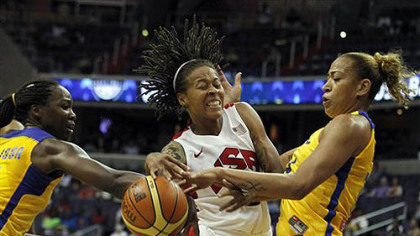 Team USA forward Seimone Augustus, center, struggles with the ball between Brazil centers Erika Cristina Dos Souza, left, and Clarissa Cristina De Santos during the first half of an Olympic women&#039;s exhibition basketball game, Monday, July 16, 2012, in Washington.