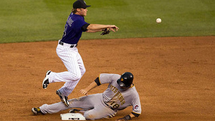 Rockies shortstop Josh Rutledge throws to first base after getting lead runner Neil Walker on a fielder&#039;s choice during the fifth inning.