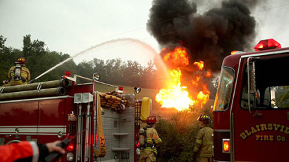 Blairsville firefighters respond to a natural gas well fire ignited by lightning in Derry during Wednesday's afternoon storms.