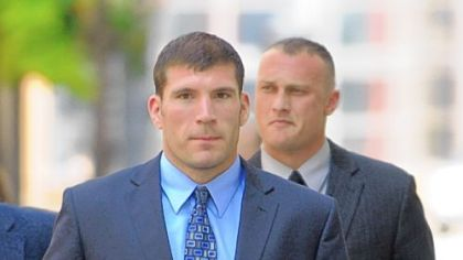 Pittsburgh police officers Michael Saldutte, left, and Richard Ewing arrive Tuesday at the U.S. District Court.