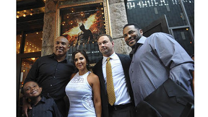 "From left, Jaydon Ward and his father Hines Ward, Alba and Thomas Tull and Jerome Bettis pose for photographs before a special preview screening of ""The Dark Knight Rises""."