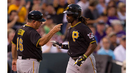 Andrew McCutchen is congratulated by third base coach Nick Leyva  after hitting a home run during the fourth inning against the Colorado Rockies.