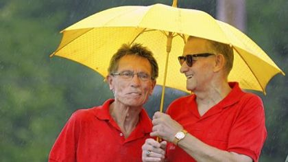 Jim Vehar, 70, and Moe Rankl, 72, both of Bethel Park, take shelter from the rain Sunday at a dedication commemorating the former Heidelberg Raceway and Sports Arena. The men started as firefighters at the old raceway in 1965.