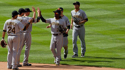 The Pirates celebrate on the field after defeating the Colorado Rockies 9-6 to win the three-game series at Coors Field  in Denver, Colorado.