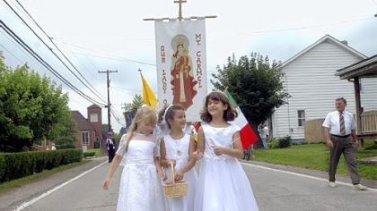 In 2004: From left, Jenny Bell, 8, Courtney Hetherton, 7, and Alexa Stynchula, 8, throw flower petals during the Our Lady of Mount Carmel procession along Route 119 in Crabtree.