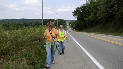 Mike Mariacher and his wife, Michelle, search Wednesday for his father, Donald Mariacher, on the shoulder of Perry Highway in Mercer County.