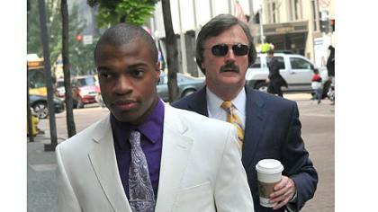 Jordan Miles, left, enters the Federal Courthouse today.