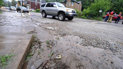 Flooding at Ramp and Baldwin streets in Hays left behind gravel and mud on the roadway.