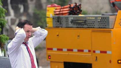 Pittsburgh Mayor Luke Ravenstahl checks on the cleanup operations in Hays.