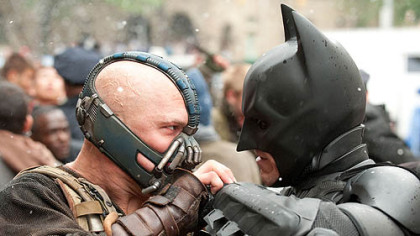 "Tom Hardy as Bane and Christian Bale as Batman face off in ""The Dark Knight Rises."""