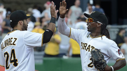Pedro Alvarez high fives center fielder Andrew McCutchen after beating the Reds.