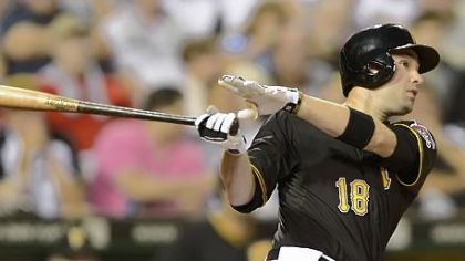 Pirates second baseman Neil Walkers hits a solo home run in the fifth inning Friday against the Marlins at PNC Park.