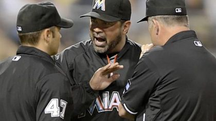 Marlins manager Ozzie Guillen, right, argues with plate umpire Mark Wegner Friday at PNC Park.